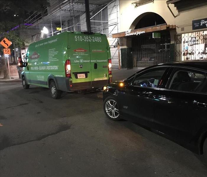 SERVPRO green van parked at commercial site at night