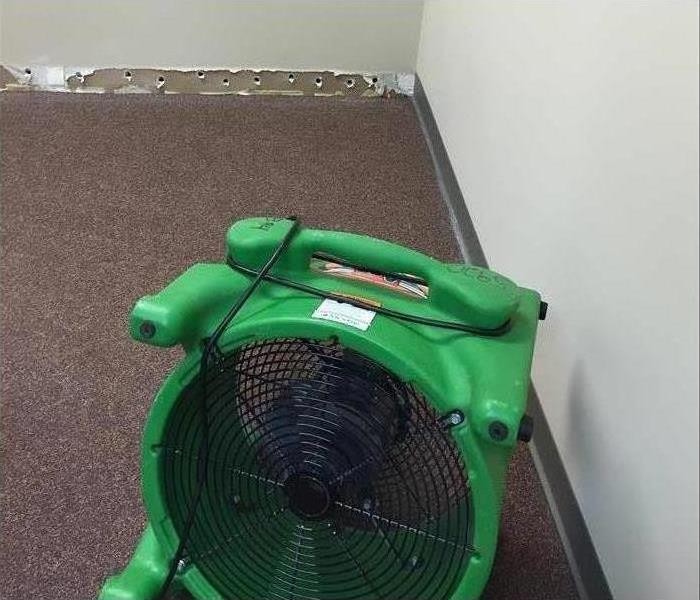 One of our air movers drying the carpet in this property